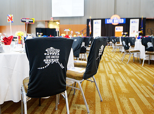 United Way of Anchorage custom LIVE UNITED t-shirt used as luncheon room decor.